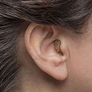 Completely-in-the-canal hearing aid for mild to severe hearing loss