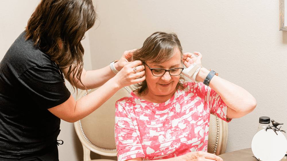 lady having a hearing aid fitted by an audiologist